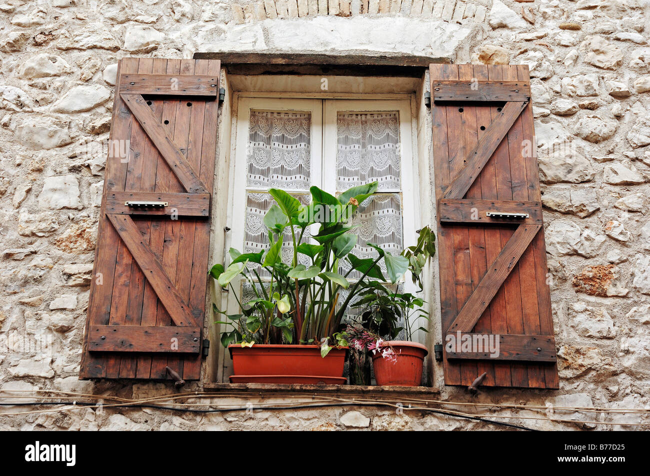 Window and shutters, La Colle sur Loup, Alpes-Maritimes, Provence-Alpes-Cote d'Azur, Southern France, France, - Stock Image