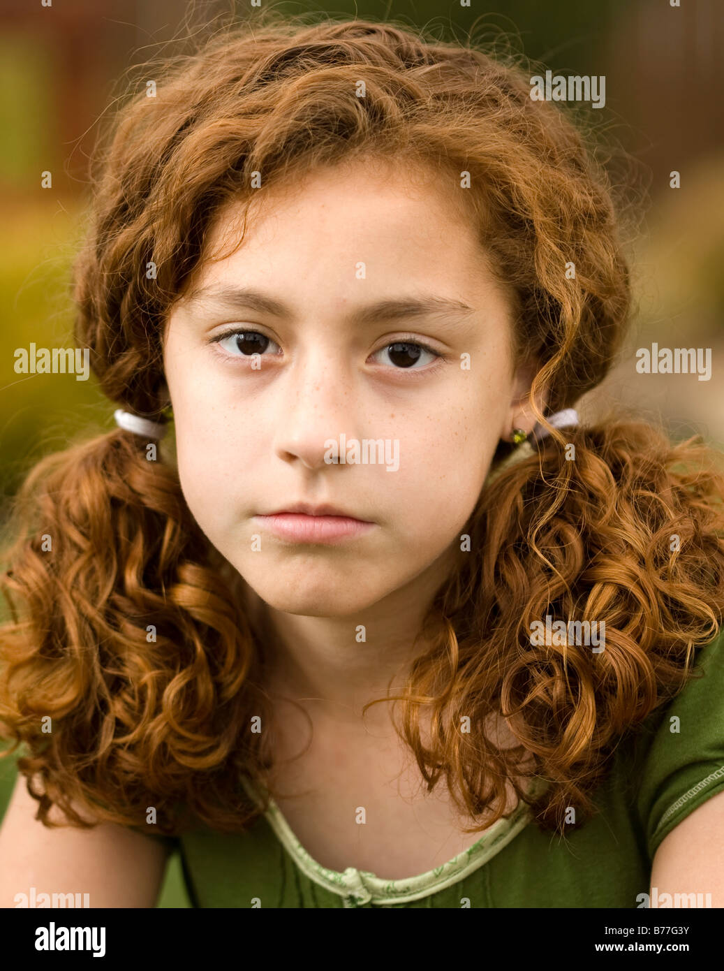 Melancholy red-headed girl. - Stock Image