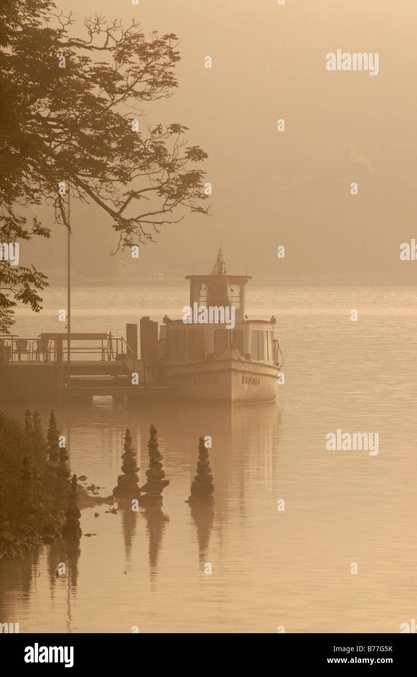 Morning fog and a ship in Grundlsee in northern Styria, Austria, Europe Stock Photo