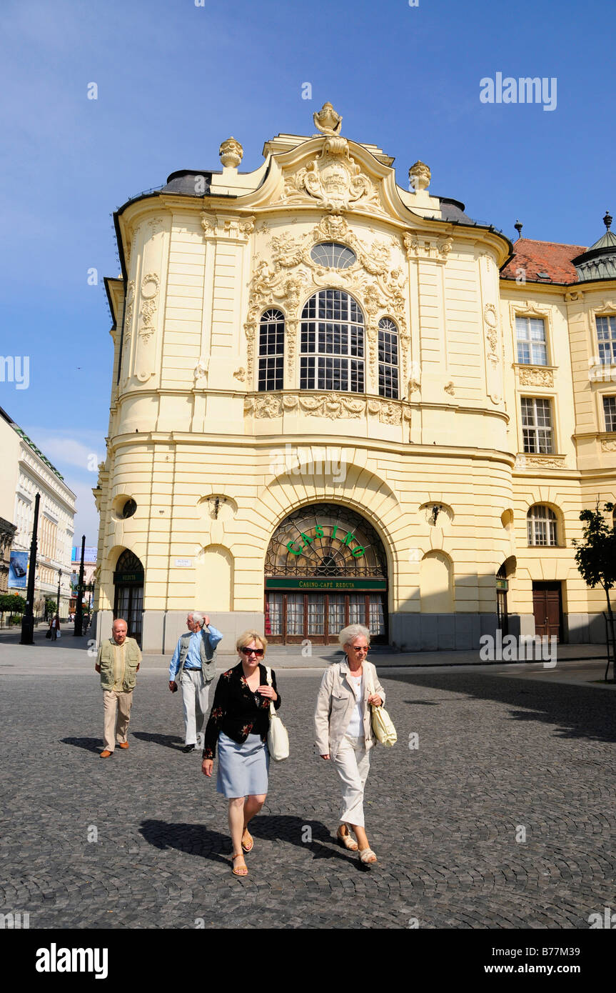 Tourists in front of the Reduta Casino, Bratislava, formerly known as Pressburg, Slovakia, Europe - Stock Image
