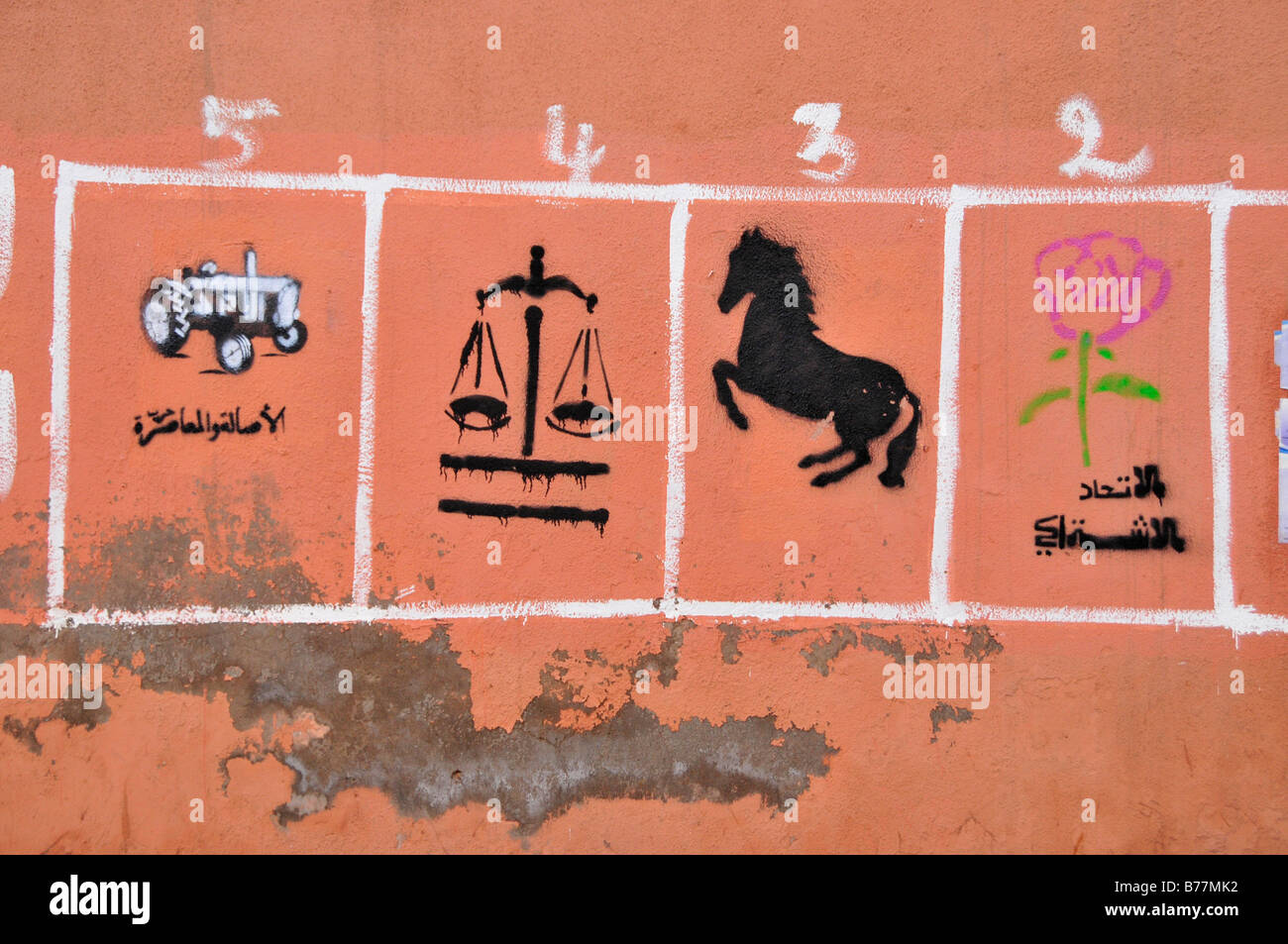 Moroccan vote advertising with the symbols of the various parties on a wall, Marrekech, Morocco, Africa - Stock Image