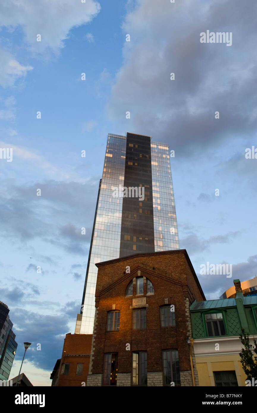 High-rise building and an old factory in the business district of Tallinn, Estonia, Baltic States, Northeastern - Stock Image