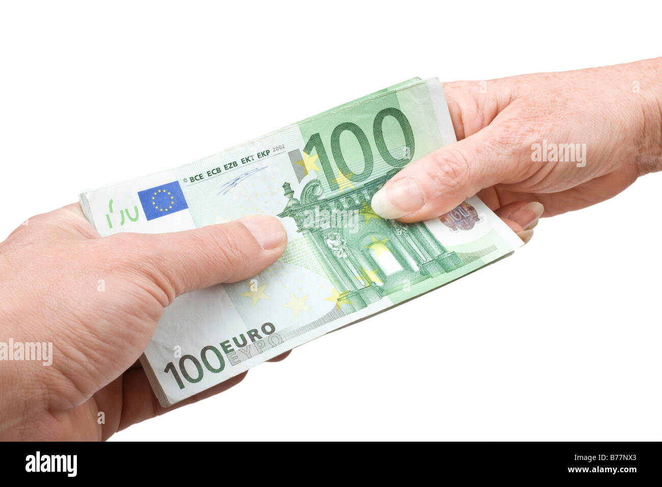 100 euro bill being handed over, hands of a man and a woman - Stock Image