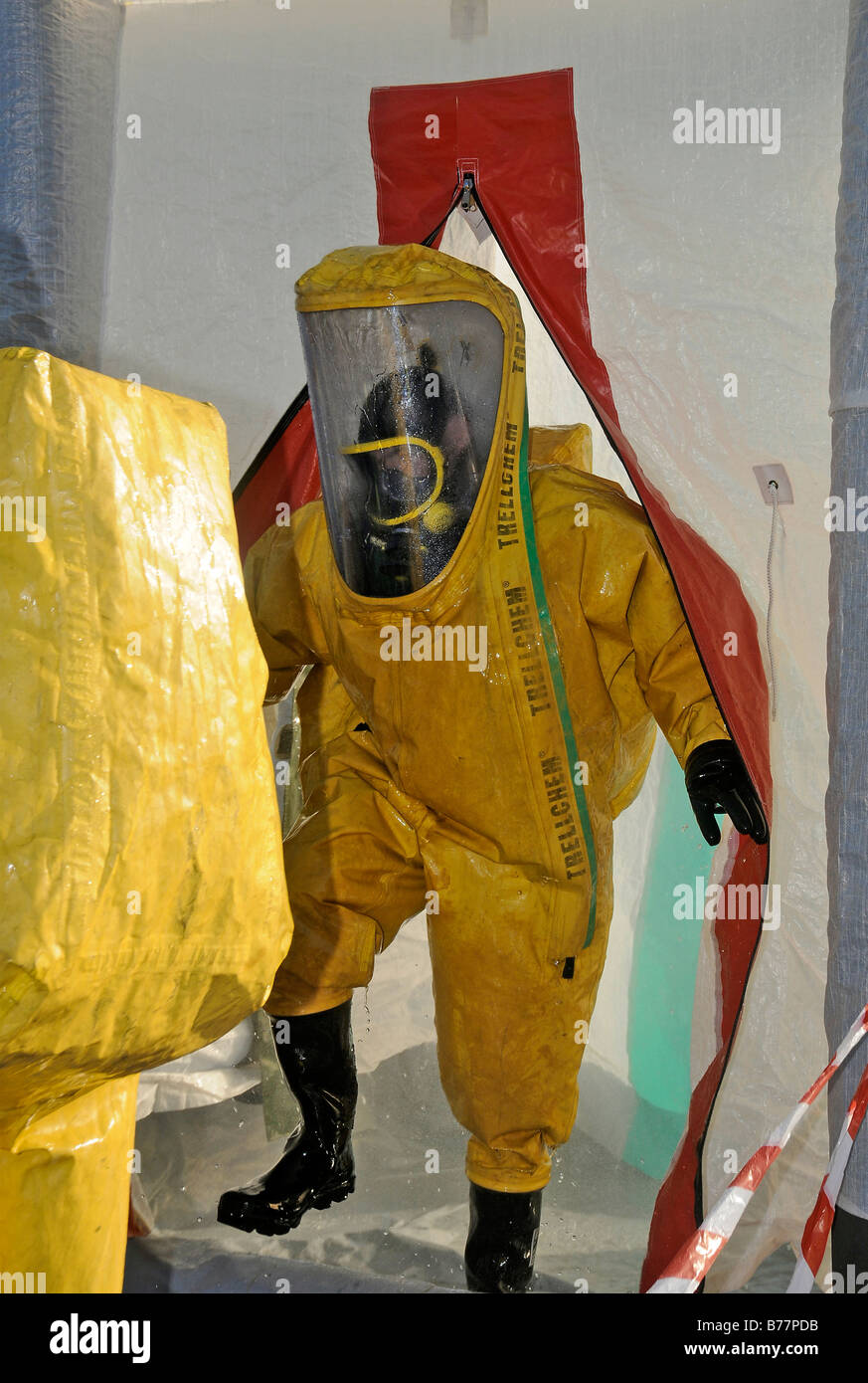 Fire crew in decontamination shower - Stock Image