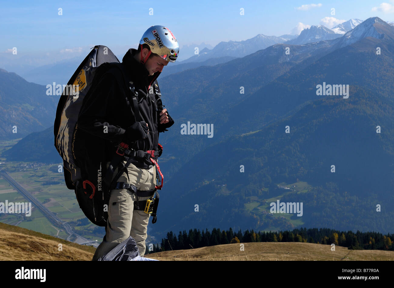 Paraglider mentally preparing for takeoff, Monte Cavallo, Sterzing, Province of Bolzano-Bozen, Italy, Europe - Stock Image