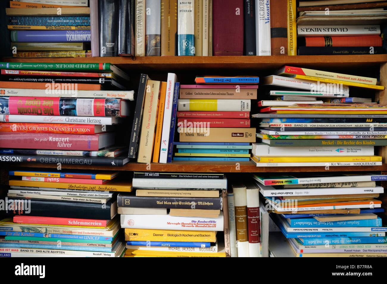 Full bookshelves, antiquarian books - Stock Image