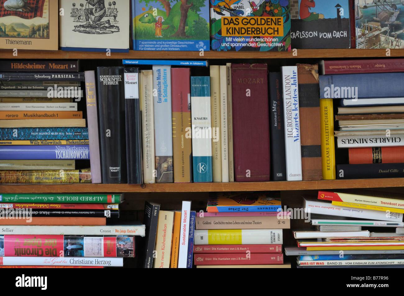 Full book shelves, antiquarian book shop, various topics - Stock Image