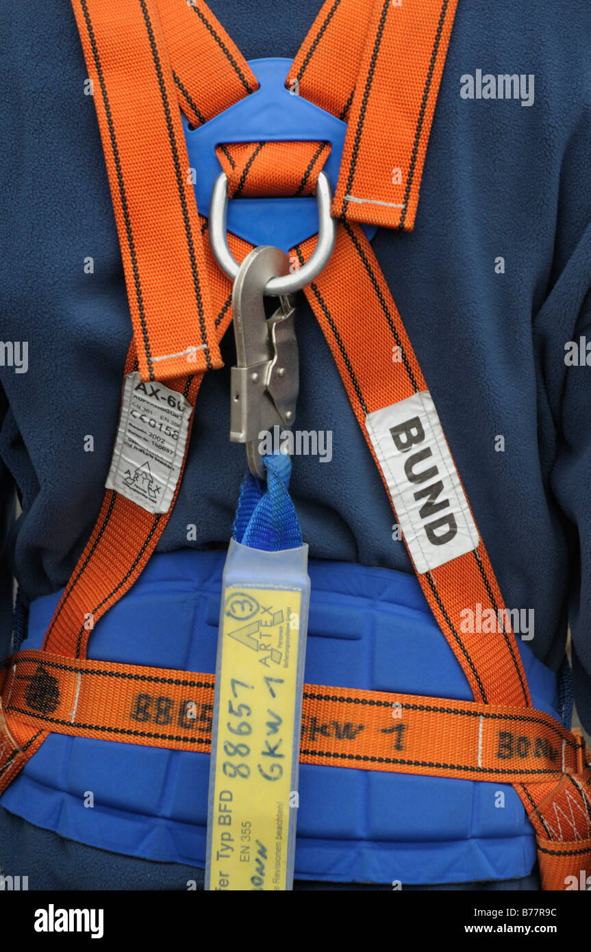 THW employee, rear view, partial view, wearing a security belt, European Norms - Stock Image