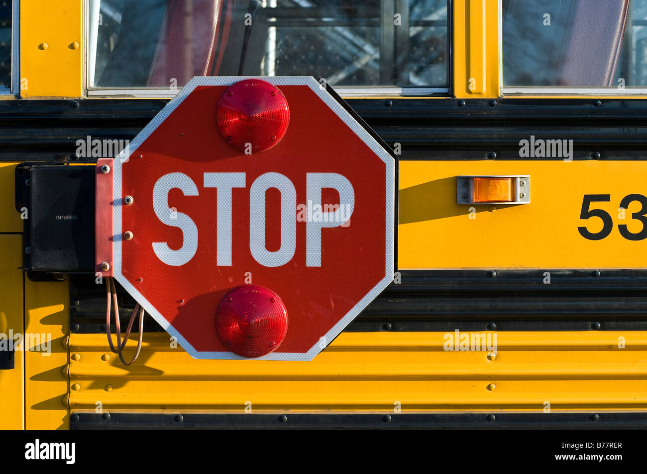 School bus with retracting safety stop sign - Stock Image
