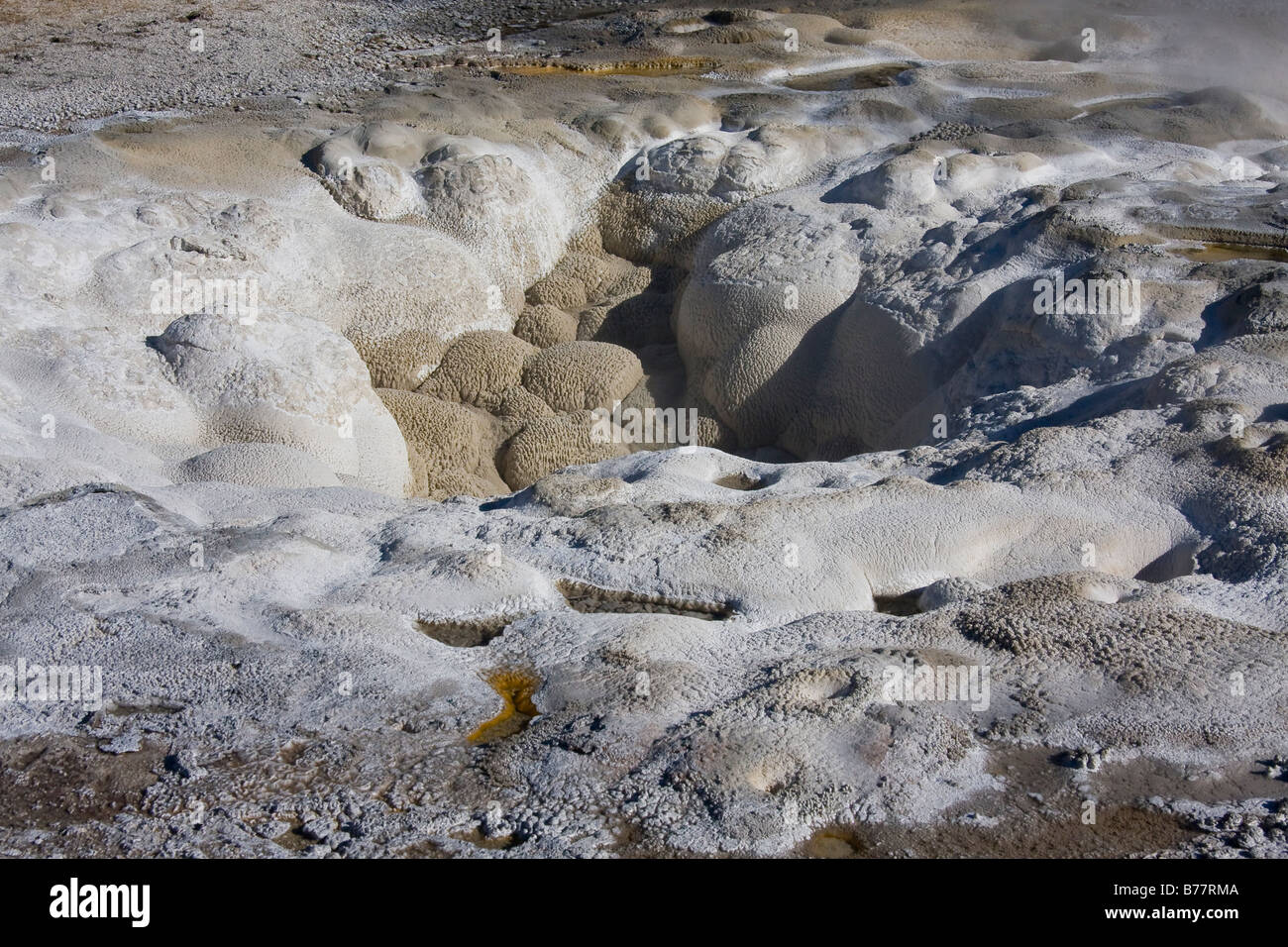 Interesting textures and rock formations surrounding a geyser vent in Yellowstone National Park - Stock Image