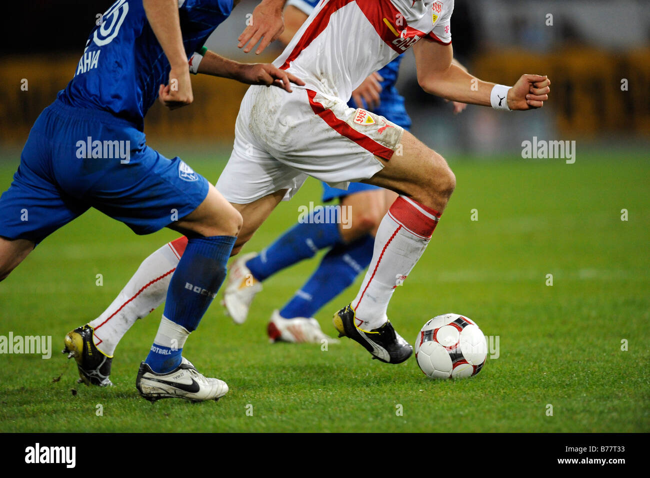 Football players battle for the ball, partial view - Stock Image