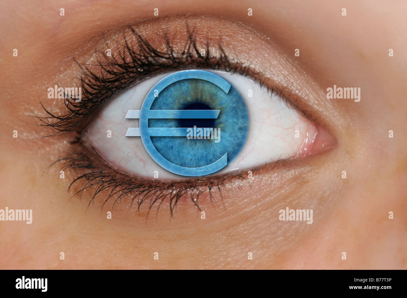 Eye with a euro symbol superimposed over a blue iris, detail, symbolic for avarice - Stock Image