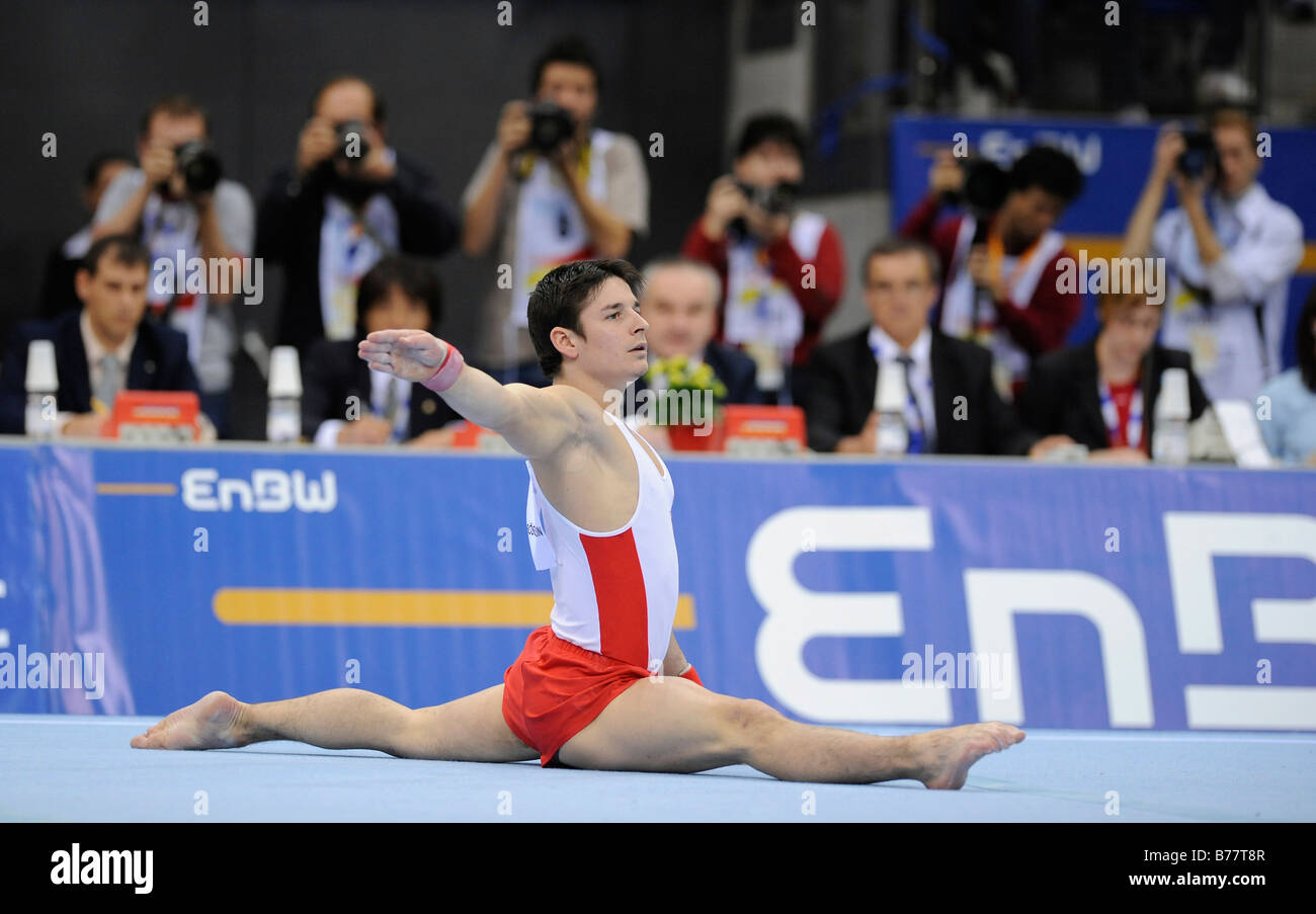 Nicolas Boeschenstein, Switzerland, performing on the floor in front of the judges and press photographers, Gymnastics Stock Photo