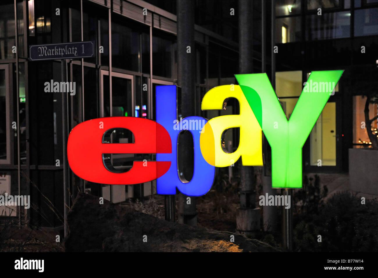 Illuminated ebay logo at night, at the main entrance of the German headquarters in Kleinmachnow near Berlin, Germany, - Stock Image