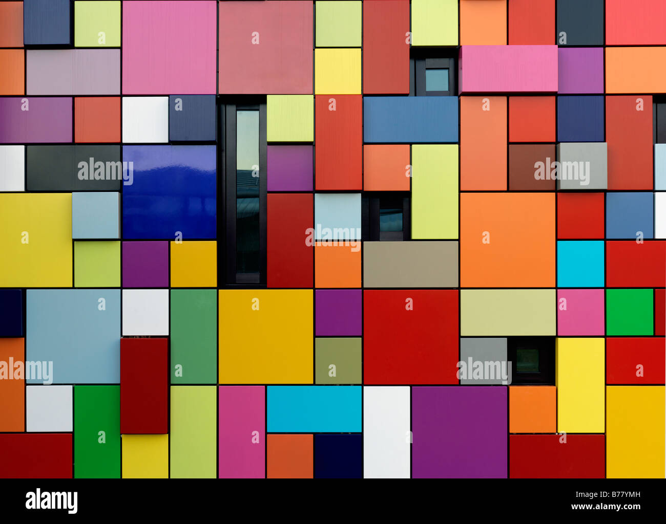 colorful multi colored building used as an entrance for parking garage at Discovery Park Synchronicity of Color - Stock Image