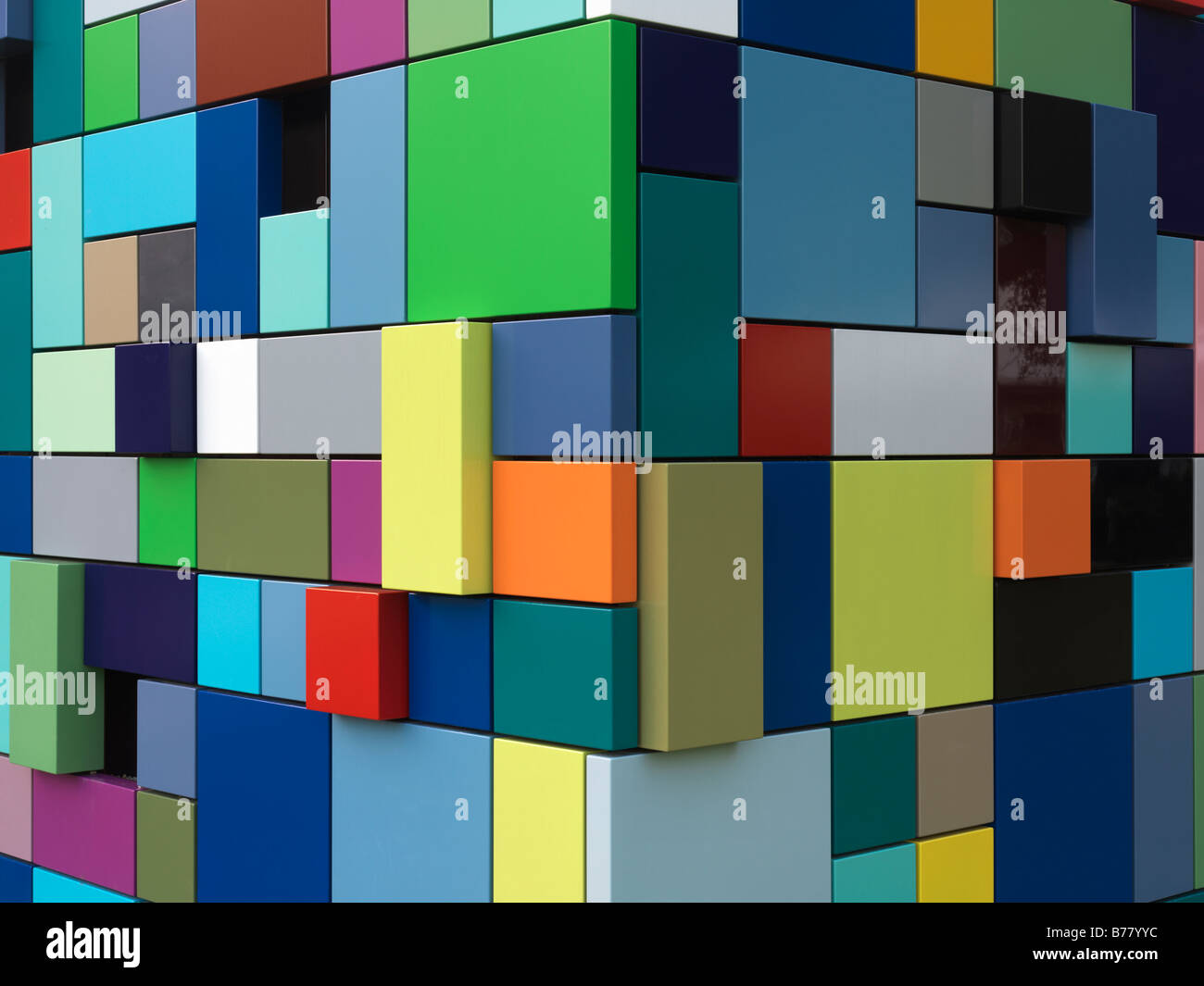 colorful multi colored building used as an entrance for parking garage at Discovery Park. Synchronicity of Color - Stock Image