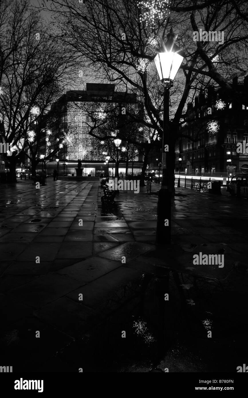 Christmas lights illuminate Sloane Square, Belgravia, London - Stock Image
