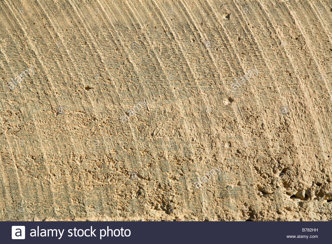 Texture rough finished concrete trowel marks grainy gray color - Stock Image