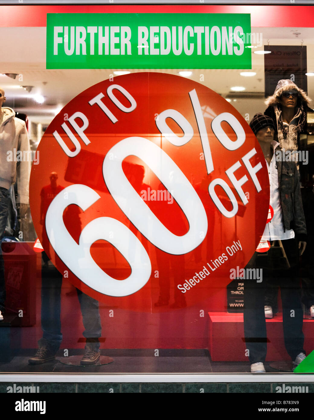 Sign in Officer's Club clothing retailer's store window advertising up to 60% off. - Stock Image