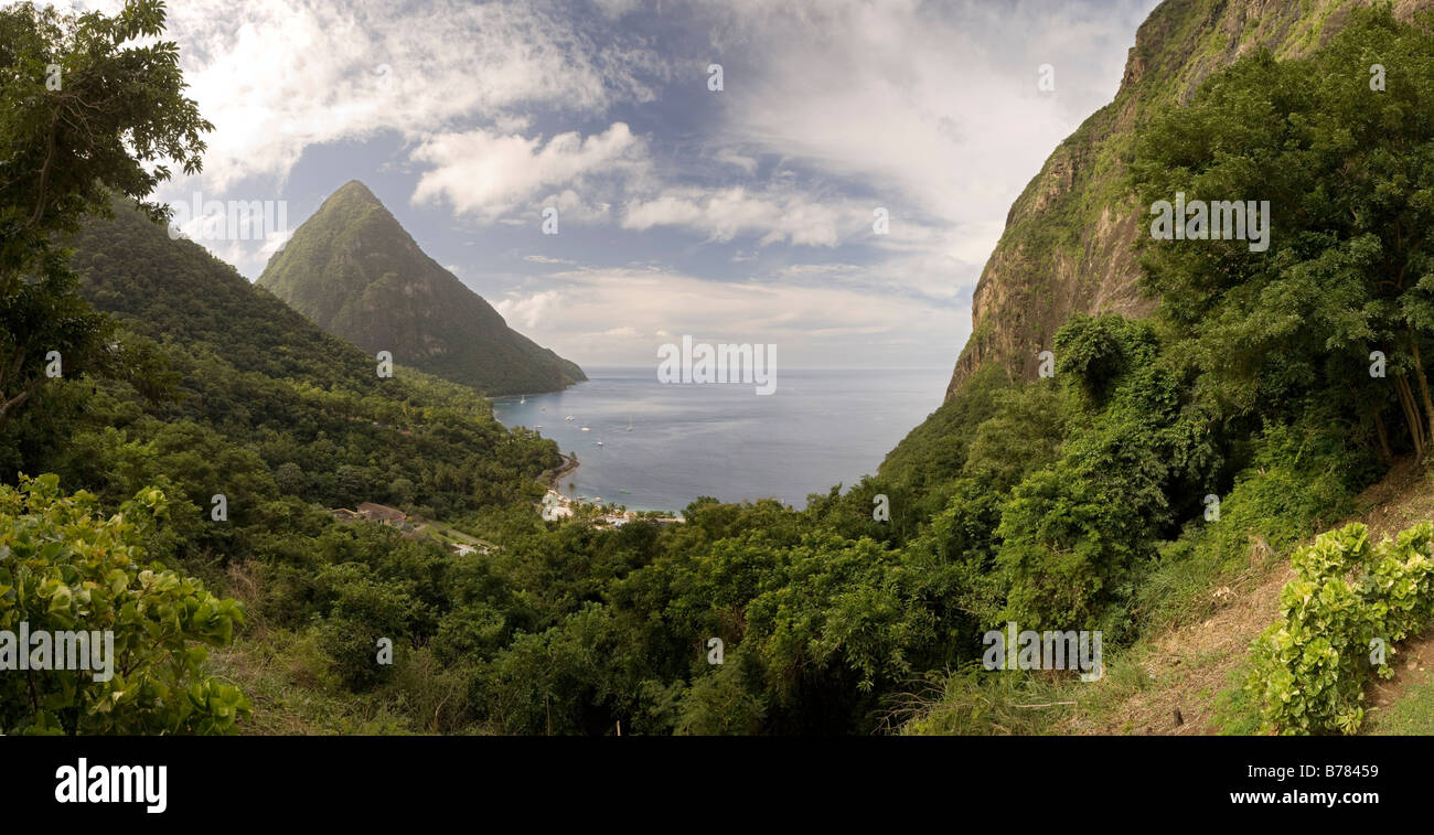 The Pitons in St Lucia and the Jalousie Hotel in the distance - Stock Image