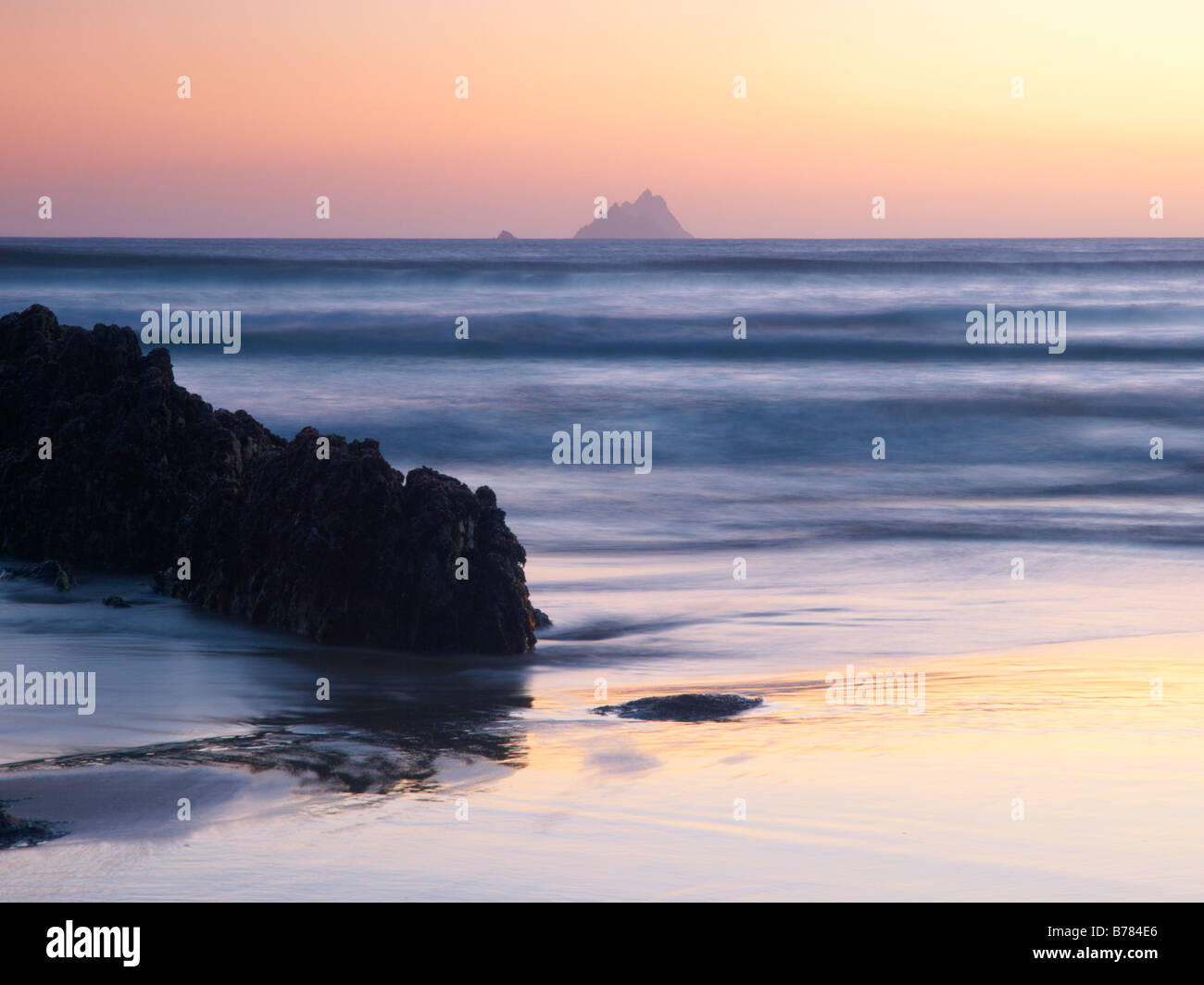 Ballinskelligs Bay, Co.Kerry, Ireland, at twilight, with Skelligs Rock in background - Stock Image