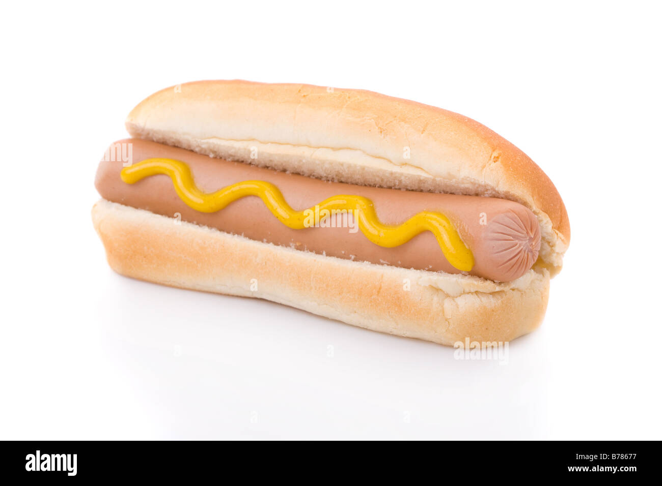 Mustard hotdog isolated on a white background - Stock Image