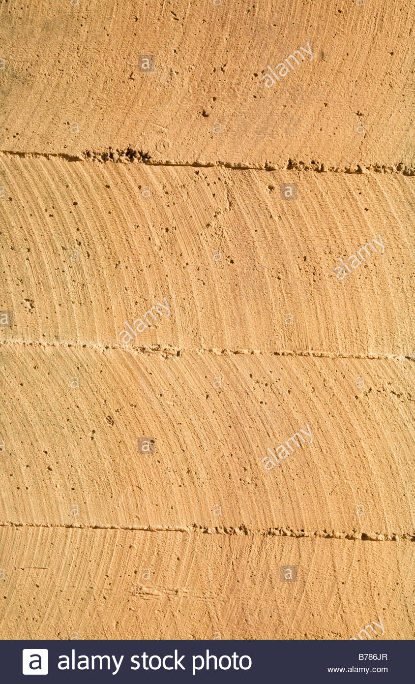 Texture rough finished concrete brown iron stain grainy - Stock Image