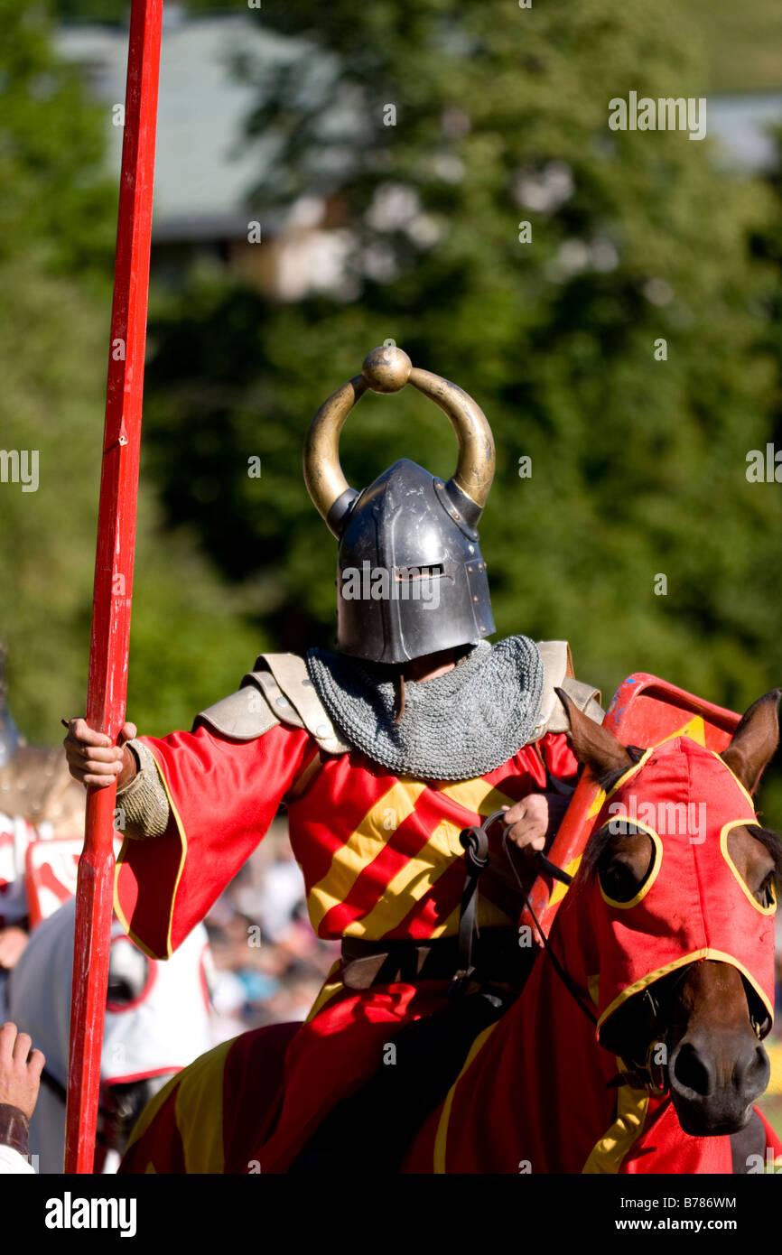 Helmetted knight on horseback at French Mediaeval fair - Stock Image