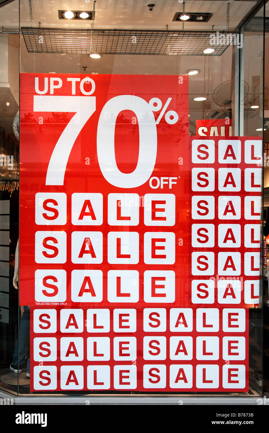 Sign in a retail store window advertising up to 70% off. - Stock Image