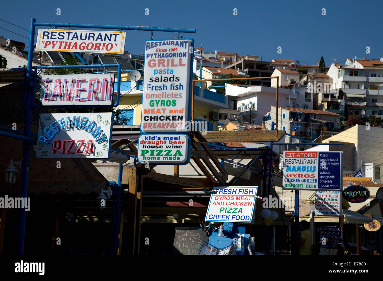 Restaurant signs on waterfront Pythagorion Samos Greece Stock Photo