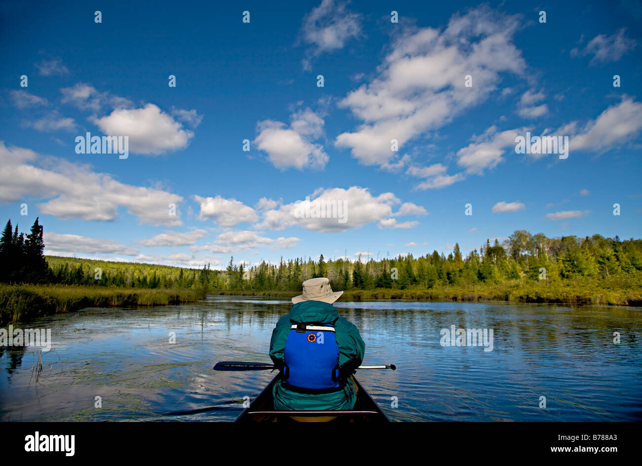 Canoeing to a new fishing spot in the Boundary Waters Canoe Area Wilderness in the Superior National Forest in Minnesota. - Stock Image