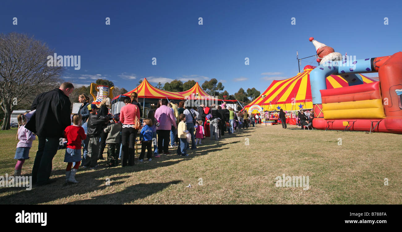 People cue wait in line to buy purchase tickets entry into the big top big top circus - Stock Image