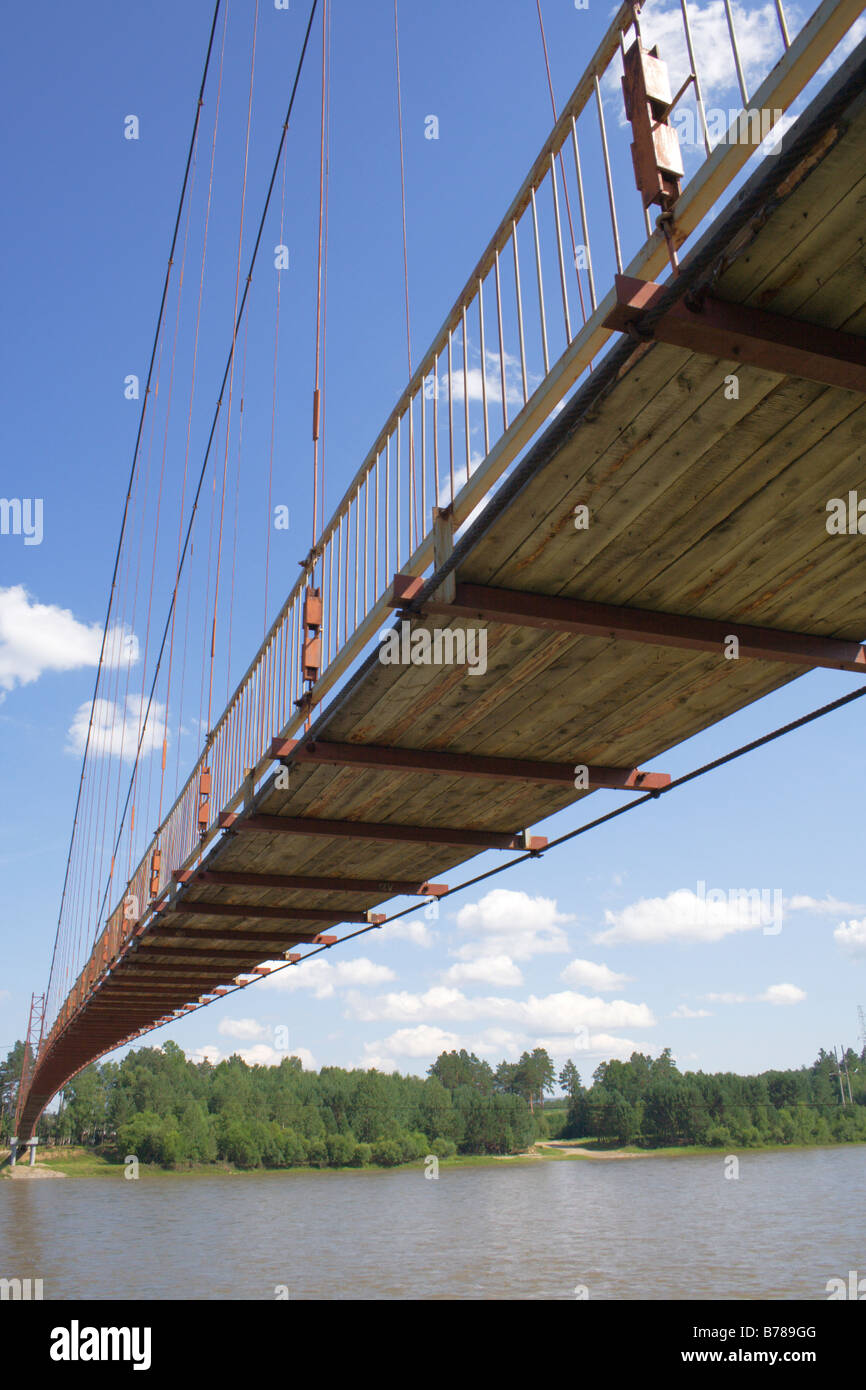 pendant footbridge over river Irkut - Stock Image