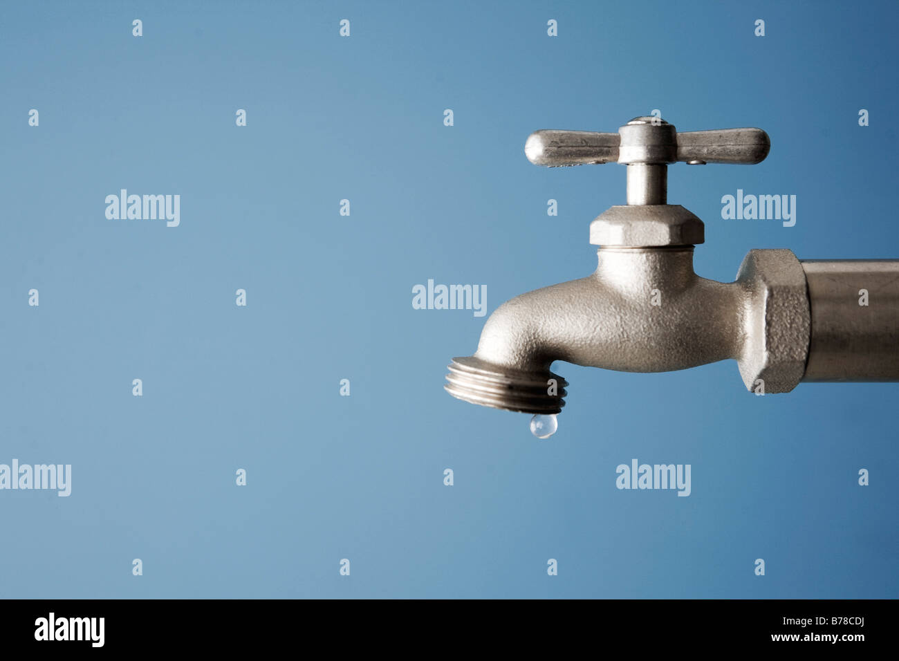 water drips from faucet - Stock Image