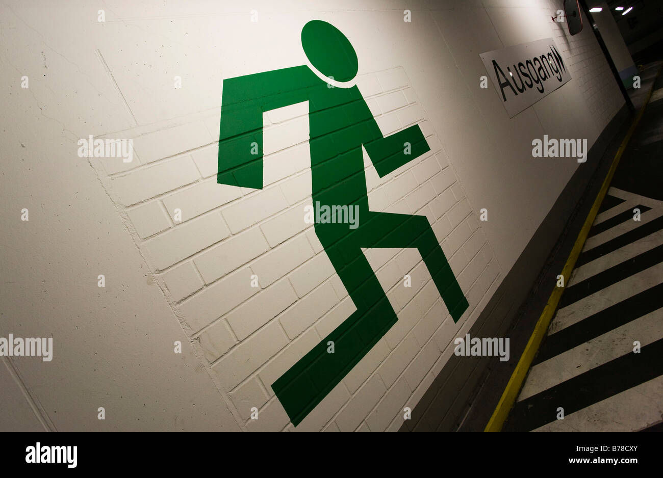 Wall painting sign for the emergency exit in a multi-story parking garage, in Frankfurt am Main, Hesse, Germany, - Stock Image