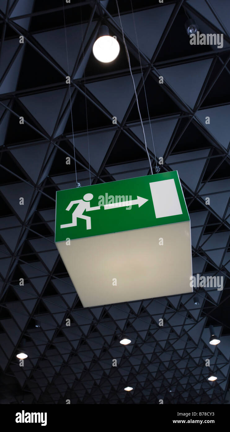 Emergency exit sign in the Frankfurt Airport, Frankfurt am Main, Hesse, Germany, Europe - Stock Image