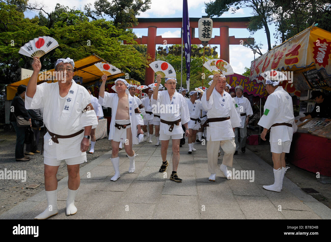 Handles of the shrines being carried accompanied by waving fans, Matsuri Shrine Festival of the Matsuo Taisha Shrine, - Stock Image