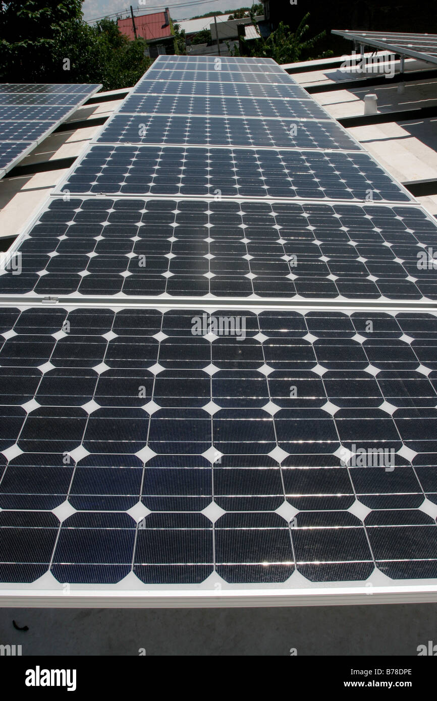 Rooftop solar panel electricity production - Stock Image