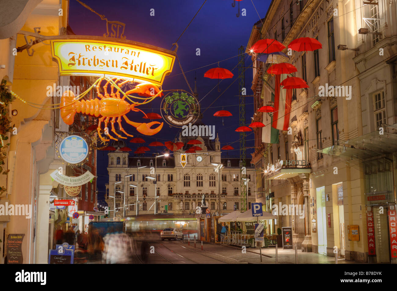 Work of art with red umbrellas in Sackstrasse street, Restaurant Krebesenkeller, Crab's Celler, in front of - Stock Image