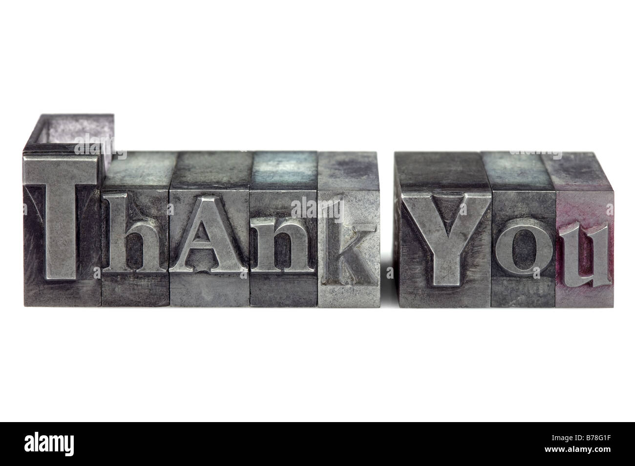 The words Thank You in old letterpress printing blocks isolated on a white background - Stock Image
