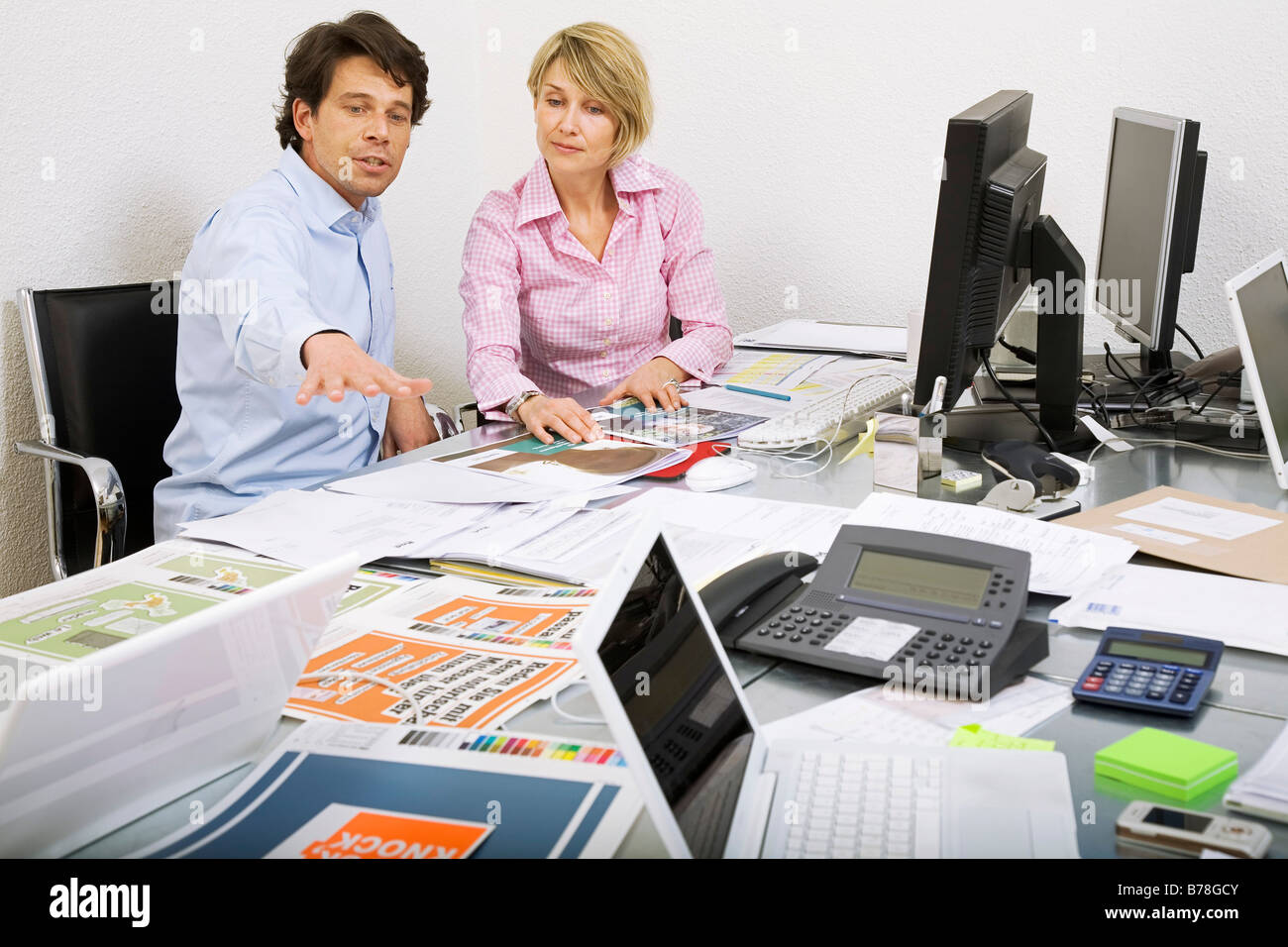 Ad agency stock photos ad agency stock images alamy employees of an advertising agency discussing an ad brochure and blueprints of an ad campaign malvernweather Gallery