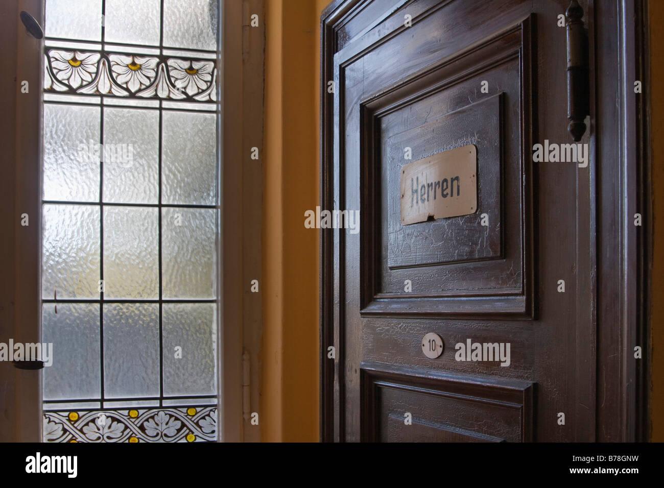 Toilet door with label 'Herren', gents, and a lead glass window, Neustrelitz, Mecklenburg-Western Pomerania, - Stock Image