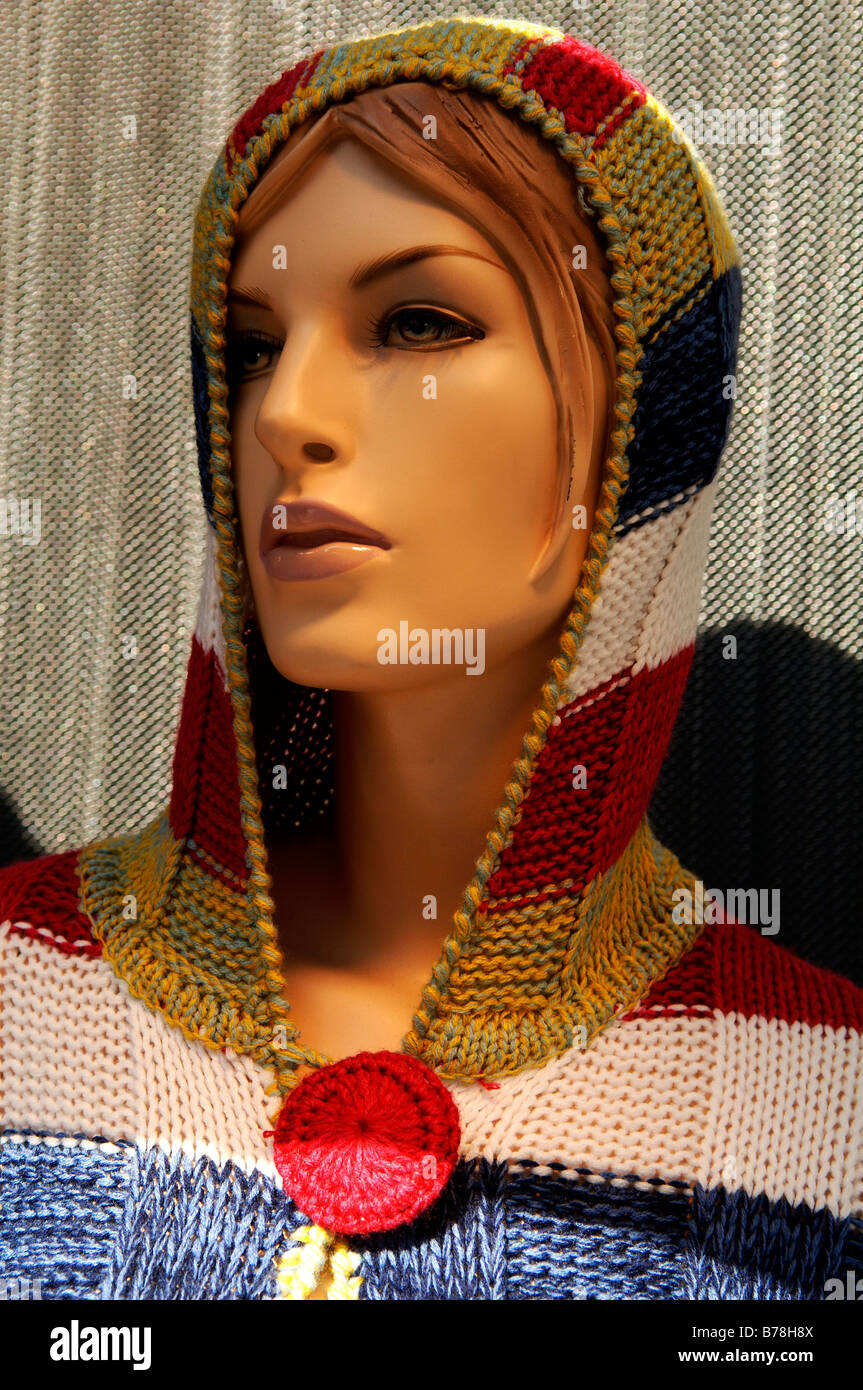 Female window dummy wearing a knitted hoodie jacket, New York City, USA - Stock Image