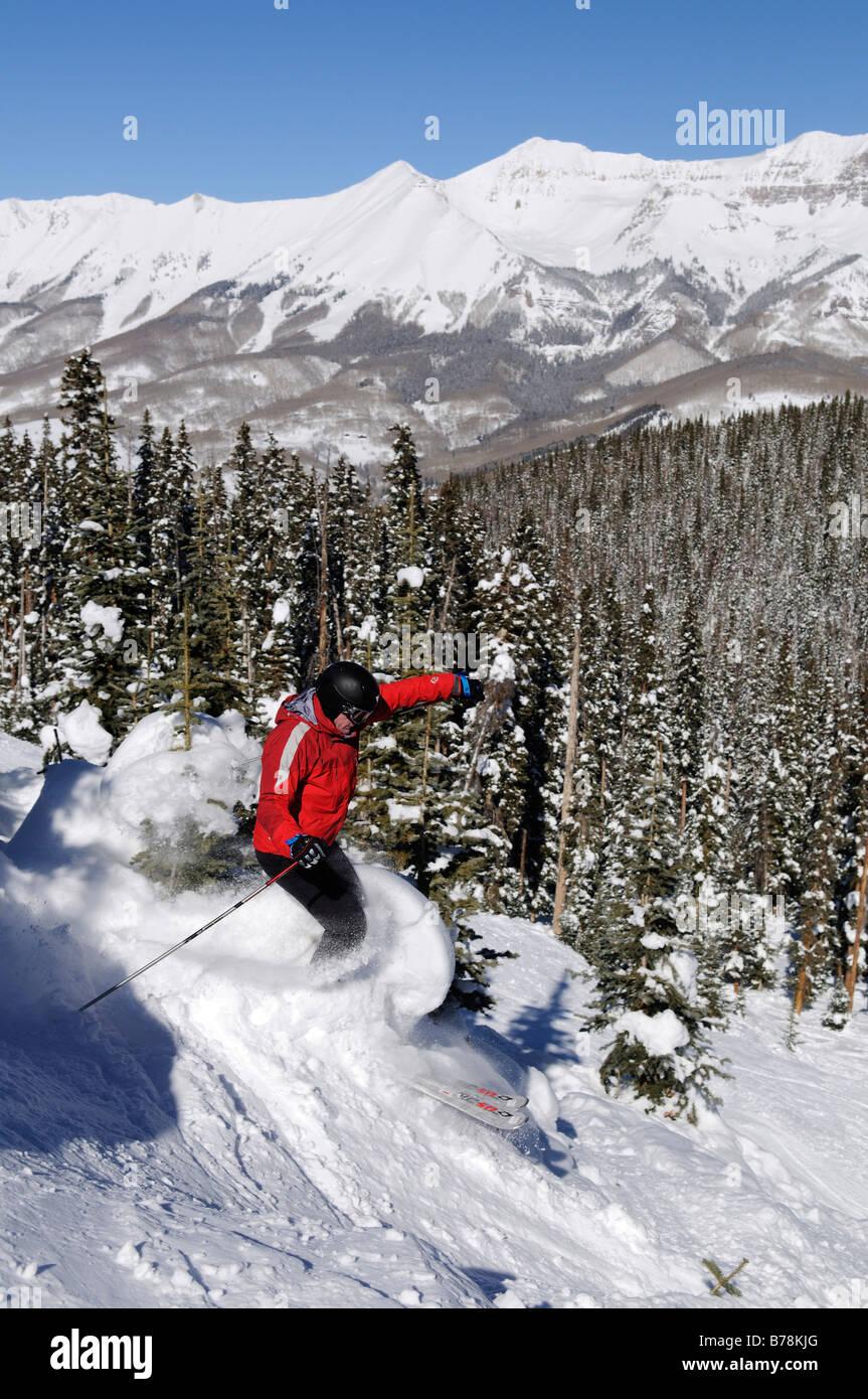 Skier on the Silvertip ski-run in Telluride, Colorado, USA, North America - Stock Image