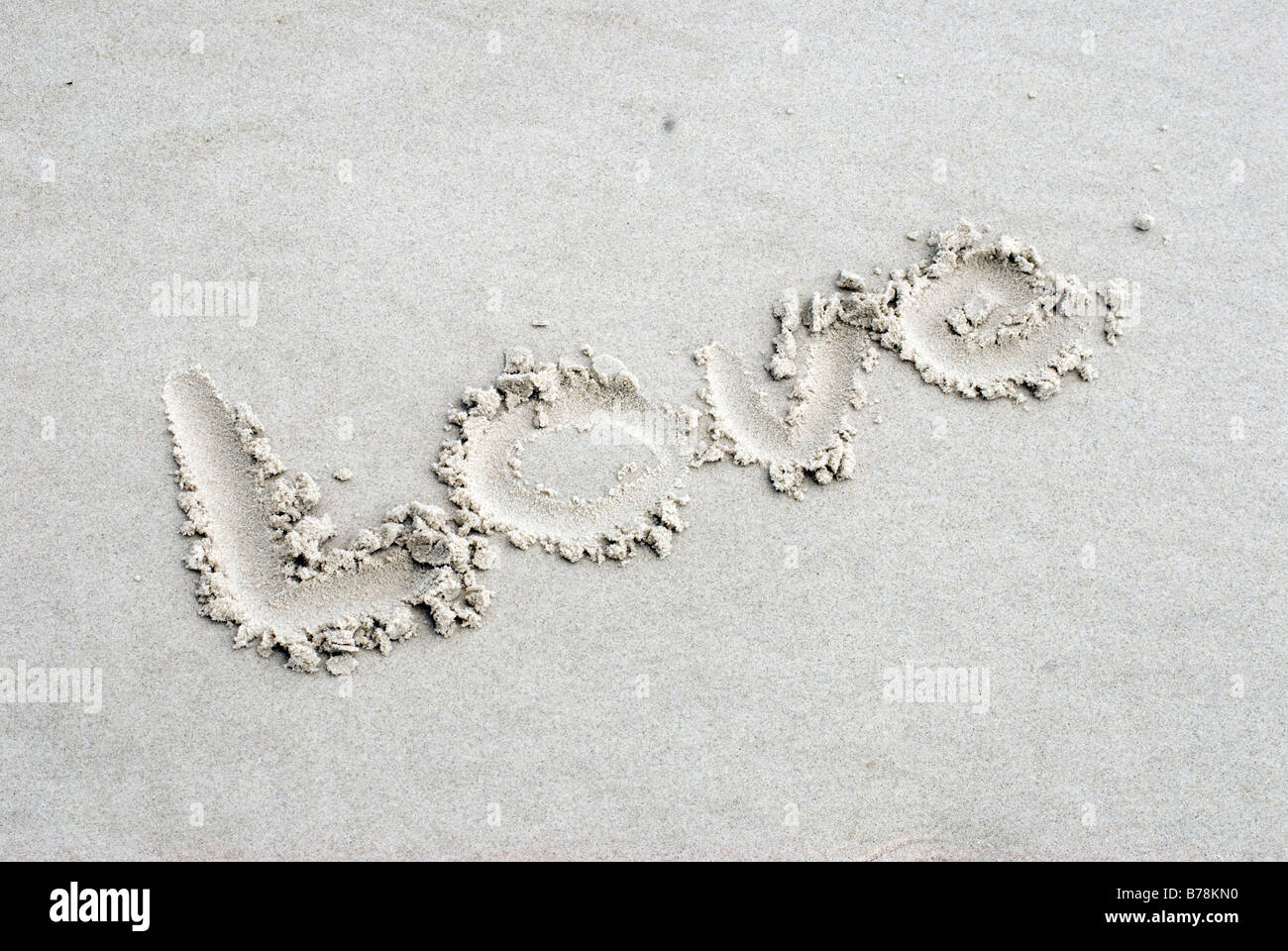 Germany, Amrum, The word Love written in sand - Stock Image