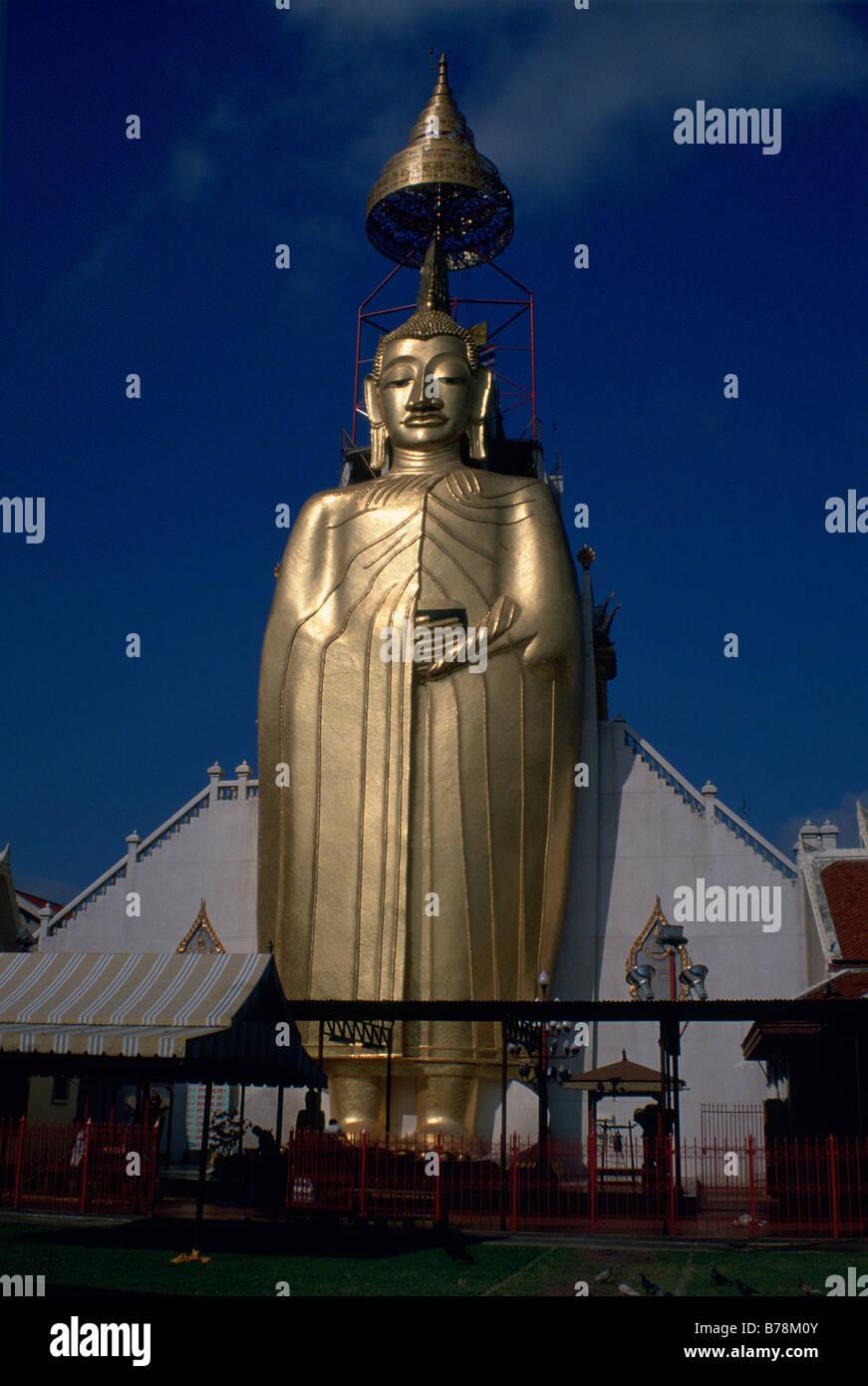 Golden Buddha statue,standing 32 meters,in Wat Intharawihan,Bangkok,Thailand - Stock Image