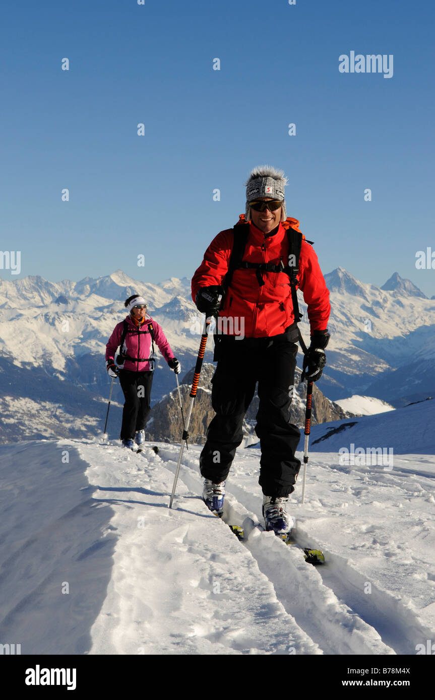 Ski mountain climbers, Les Diableretes, skiing area Glacier 3000, Gstaad, West Alps, Bernese upper country, Switzerland, - Stock Image