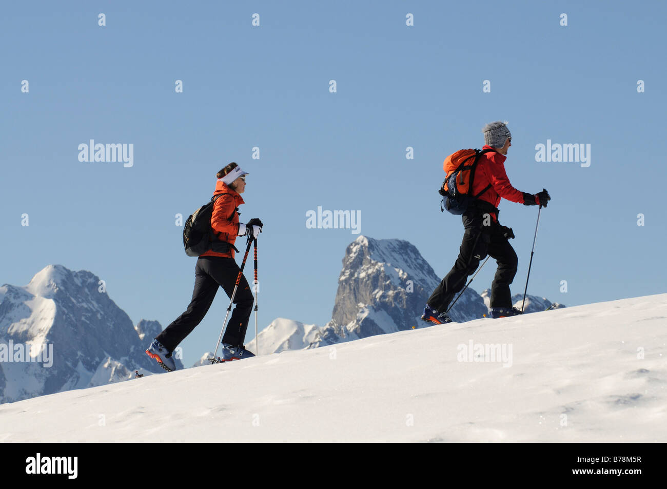 Ski mountain climbers, Zweisimmen, Rueblihorn, Gummfluh, Saanenland, Gstaad, West Alps, Bernese upper country, Switzerland, - Stock Image