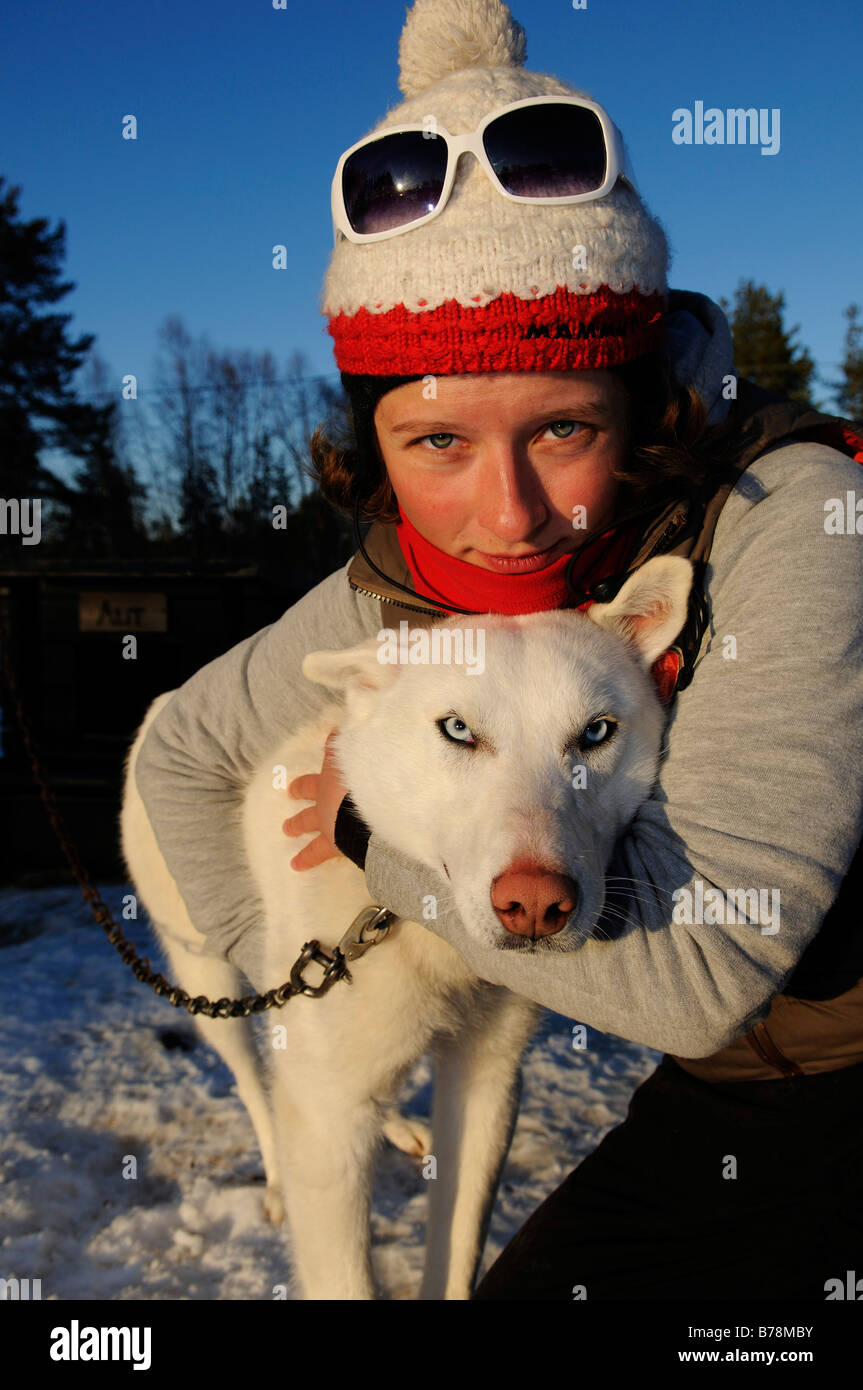 Woman with husky on a sledge dog-tour near Melkefoss, Finnmark, Lapland, Norway, Scandinavia, Europe - Stock Image