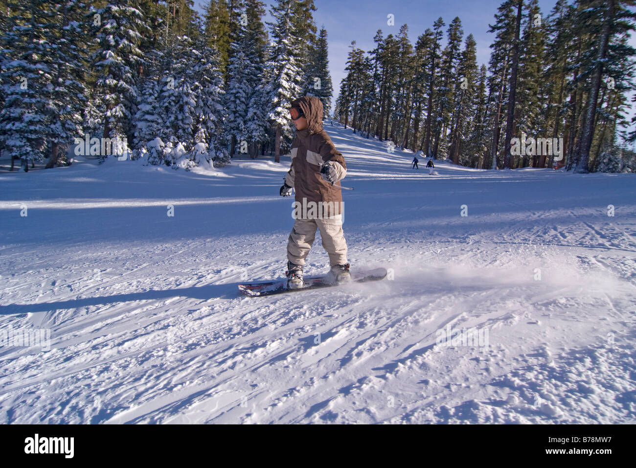 a boy snowboarding at sierra at tahoe ski resort near lake tahoe in